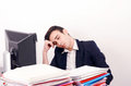 Tired business man sleeping at work exhausted worker the desk in the office Stock Photos