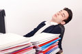 Tired business man sleeping at work exhausted worker the desk in the office Stock Photo