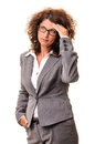Tired business woman looking up stressed with problems headache hand on head standing isolated on white Royalty Free Stock Photo