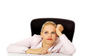 Tired business woman sitting behind the desk Royalty Free Stock Photo