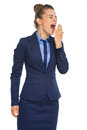 Tired business woman yawning Royalty Free Stock Photo