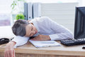 Tired businesswoman sleeping at her desk businessman on the office Stock Images