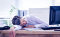 Tired businesswoman sleeping at her desk businessman on the office Stock Photography