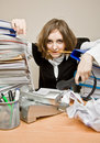 Tired businesswoman with telephones Stock Images