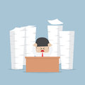 Tired and busy businessman with piles of work to do Royalty Free Stock Photo