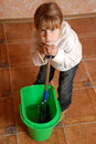 Tired child cleaning up Royalty Free Stock Photo