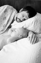 Tired Dad And Baby Son Sleeping