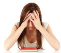 Tired, depressed female student with book Royalty Free Stock Photo