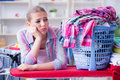 The tired depressed housewife doing laundry Royalty Free Stock Photo