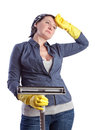 Tired and exhausted after a middle aged housewife cleaning the house Stock Photo