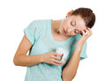 Tired fatigued woman closeup portrait sleepy young holding cup about to crash fall asleep eyes closed looking bored isolated white Stock Photography