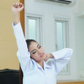 Tired female doctor stretching model is asian woman Stock Image