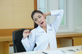 Tired female doctor stretching model is asian woman Stock Photo