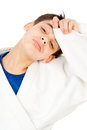 Tired of fighting boy holding his head wiped the sweat Stock Photo