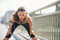 Tired fitness young woman catching breathe portrait of Royalty Free Stock Images