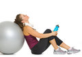 Tired fitness young woman relaxing after workout on fitness ball Royalty Free Stock Images
