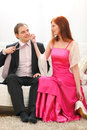 Tired formally dressed couple returns from party Royalty Free Stock Image