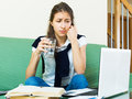 Tired girl behind her laptop Royalty Free Stock Photo