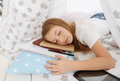 Tired girl sleeping after working hard on home assignment Royalty Free Stock Photo