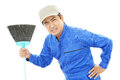 Tired Janitorial cleaning service Royalty Free Stock Photo