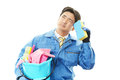Tired janitorial cleaning service the male worker who are on white background Stock Photography