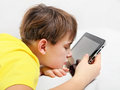 Tired Kid with Tablet Computer Royalty Free Stock Photo