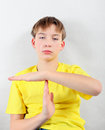 Tired Kid with Time-out Gesture Royalty Free Stock Photo
