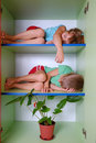 Tired kids in a closet Stock Photos