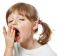 A tired little girl yawning Stock Image