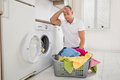 Tired Man Loading Clothes Into The Washing Machine Royalty Free Stock Photo