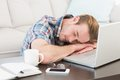 Tired man sleeping on his laptop Royalty Free Stock Photo