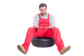 Tired mechanic looking at his dirty hands Royalty Free Stock Photo