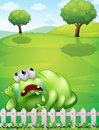 A tired monster at the hilltop resting near the fence illustration of Royalty Free Stock Photo