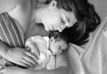 Tired mother with new born baby boy ion her arms Royalty Free Stock Photo