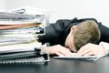 Tired office worker pile documents folders Stock Image