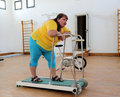 Tired overweight woman on trainer treadmill fitness Stock Photos