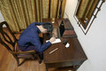 Tired overworking man chinese business overworked at home sleeping on desk Royalty Free Stock Photography
