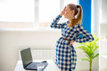 Tired pregnant woman working in office Royalty Free Stock Photo