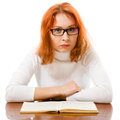 Tired red-haired girl in glasses with book. Royalty Free Stock Photos