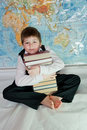 Tired schoolboy with a pile of books Stock Photography