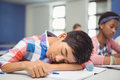 Tired schoolboy sleeping in classroom Royalty Free Stock Photo