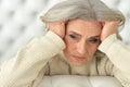 Tired senior woman