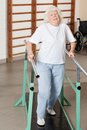 Tired senior woman on walking track full length portrait of a at hospital gym Stock Photos
