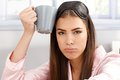 Tired sleepy woman with coffee mug Royalty Free Stock Photo