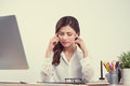 Tired sleepy woman yawning, working at office desk. Overwork and Royalty Free Stock Photo