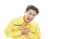 Tired and stressed asian worker adult man suffering from severe heartache Stock Photography