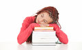 Tired student girl asleep on the stack of books Stock Photo