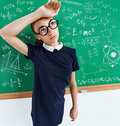 Tired student solved all the examples on the blackboard. Royalty Free Stock Photo