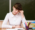 Tired teacher in classroom Royalty Free Stock Photo