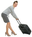 Tired traveling woman hauling suitcase Stock Photography